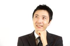 Uomo d'affari giapponese che sogna al suo futuro Immagine Stock Libera da Diritti