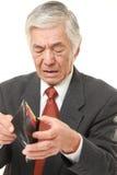 Uomo d'affari giapponese senior povero Fotografia Stock Libera da Diritti
