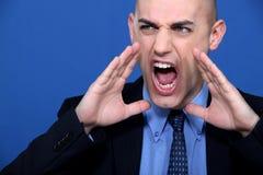 Uomo d'affari gridante Immagini Stock