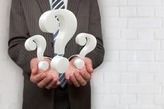Uomo d'affari Hands 3 domande Immagini Stock Libere da Diritti
