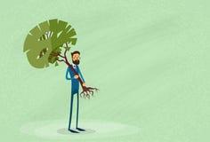 Uomo d'affari Holding Green Tree ambientale Immagine Stock