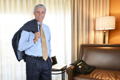Uomo d'affari Hotel Room Immagini Stock