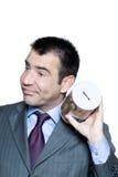 Uomo d'affari imbronciato con un contenitore di soldi vuoto Fotografia Stock Libera da Diritti