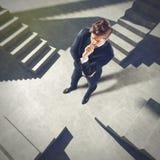 Uomo d'affari indeciso su futuro Immagini Stock Libere da Diritti