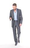 Uomo d'affari integrale del ritratto con il telefono mobile Immagine Stock Libera da Diritti