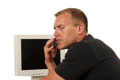 Uomo d'affari interessato sul telefono Immagine Stock Libera da Diritti