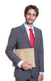 Uomo d'affari latino sorridente con l'archivio Fotografie Stock Libere da Diritti