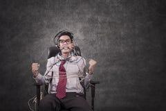 Uomo d'affari legato e lavagna in bianco Fotografia Stock Libera da Diritti