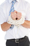 Uomo d'affari legato su nella corda Immagine Stock Libera da Diritti