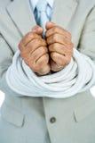 Uomo d'affari legato su nella corda Immagini Stock Libere da Diritti