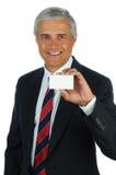 Uomo d'affari maggiore con il biglietto da visita Immagini Stock Libere da Diritti