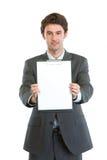 Uomo d'affari moderno che mostra appunti in bianco Immagine Stock Libera da Diritti