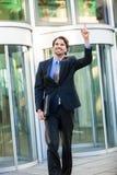 Uomo d'affari motivato che perfora l'aria Fotografie Stock Libere da Diritti