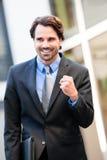 Uomo d'affari motivato che perfora l'aria Fotografia Stock Libera da Diritti