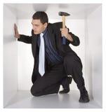 Uomo d'affari nel cubo Immagine Stock