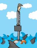 Uomo d'affari circondato dagli squali Fotografia Stock