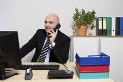 Uomo d'affari nel suo ufficio Immagine Stock