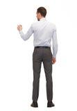 Uomo d'affari o insegnante con l'indicatore dalla parte posteriore Fotografie Stock Libere da Diritti
