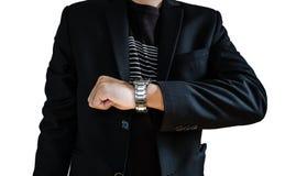 Uomo d'affari in orologi di sorveglianza del vestito casuale, isolati su fondo bianco Immagini Stock Libere da Diritti