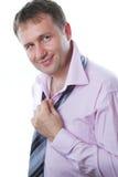 Uomo d'affari per legare un legame Fotografia Stock