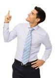 Uomo d'affari Pointing Upwards Fotografia Stock