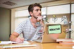 Uomo d'affari premuroso con i grafici di vendita e del computer portatile in ufficio Immagine Stock Libera da Diritti