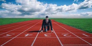 Uomo d'affari pronto a sprintare sulla linea di partenza Immagini Stock