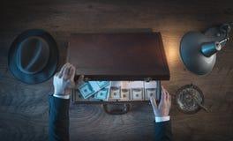 Uomo d'affari ricco con i pacchetti del dollaro Fotografia Stock Libera da Diritti