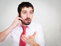 uomo d'affari con un telefono Fotografia Stock