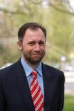 Uomo d'affari sorridente Fotografie Stock