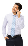Uomo d'affari sorridente Answering Smart Phone Fotografie Stock Libere da Diritti