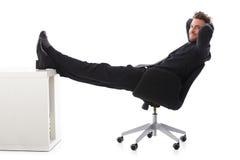 Uomo d'affari sorridente che cattura una rottura Fotografia Stock