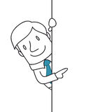 Uomo d'affari sorridente che indica al segno in bianco illustrazione di stock