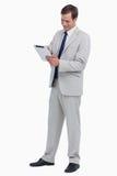Uomo d'affari sorridente che per mezzo del calcolatore del ridurre in pani Immagine Stock Libera da Diritti