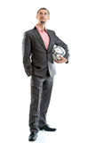 Uomo d'affari sorridente con un calcio fotografia stock