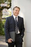 Uomo d'affari sorridente felice immagini stock