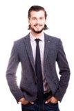 Uomo d'affari sorridente sicuro nell'usura convenzionale Fotografie Stock Libere da Diritti