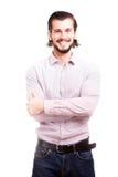 Uomo d'affari sorridente sicuro nell'usura convenzionale Immagine Stock