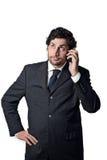 Uomo d'affari su un telefono mobile Fotografia Stock