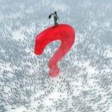 Uomo d'affari su una cima del punto interrogativo Fotografia Stock Libera da Diritti