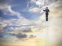 Uomo d'affari su una scala Fotografia Stock