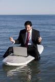 Uomo d'affari sul surf Fotografia Stock Libera da Diritti