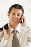 Uomo d'affari sul telefono delle cellule Fotografie Stock