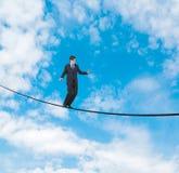 Uomo d'affari sulla corda Fotografia Stock Libera da Diritti