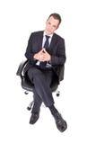 Uomo d'affari sulla presidenza immagine stock