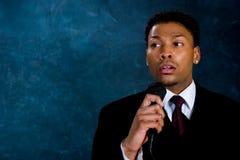 Uomo d'affari - tempo di discorso Immagine Stock