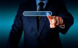 Uomo d'affari Touching Magnifier Icon in search box Immagini Stock Libere da Diritti
