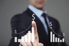 Uomo d'affari Touching un grafico che indica crescita Simbolo di dollaro Immagini Stock Libere da Diritti