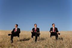 Uomo d'affari tre al campo immagini stock libere da diritti