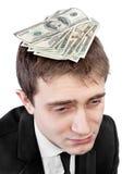 Uomo d'affari turbato con soldi sulla testa Immagini Stock
